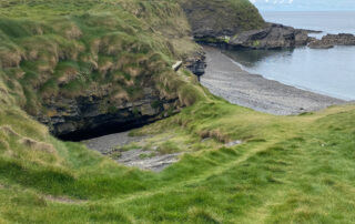 green grass overlooking an inlet and wild atlantic way